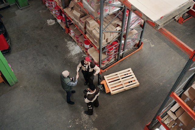 warehouse crew discussing plans