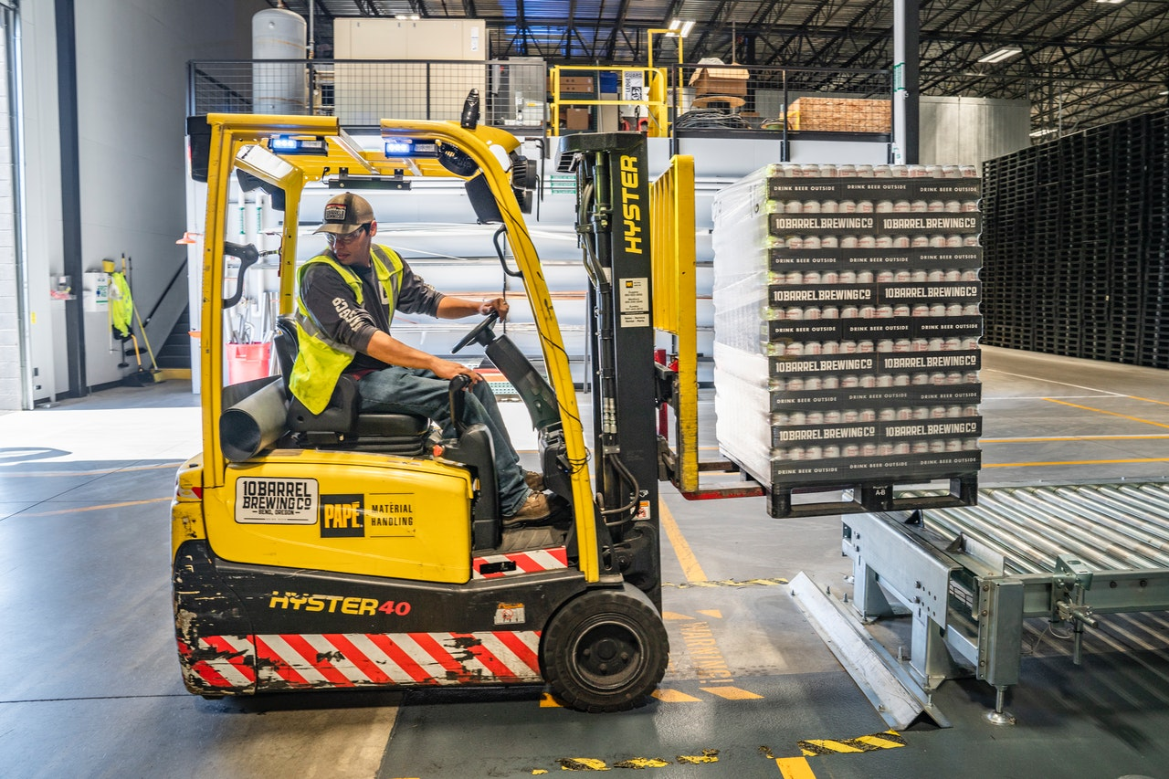 man operating warehouse forklift