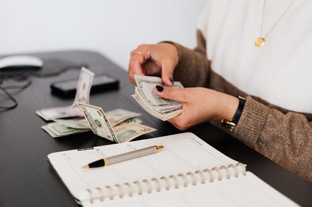 woman counting bills