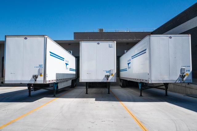 shipping trucks at loading dock
